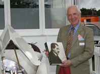 Karl Ludvigsen with a copy of Ferdinand Porsche - Genesis of Genius
